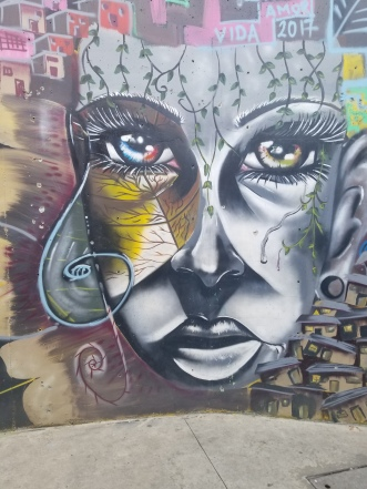Mural of woman painted in gray in Comuna 13. Medellin Colombia